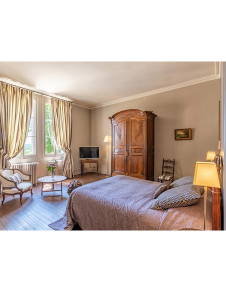Chambre de grand confort, un cocon de 35 m2 avec ambiance intimise et sa vue sur le parc...